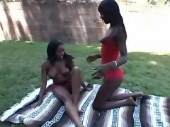 Two busty black lesbians lick each other